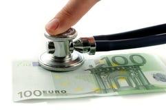 Euro com estetoscópio e dedo Imagens de Stock Royalty Free