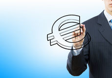 Euro concept. Close up of businessman drawing euro symbol with marker Royalty Free Stock Photo