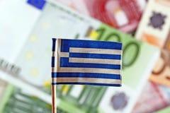 Euro- contas e bandeira grega Imagem de Stock