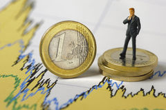 Euro crisis. Euro coin on chart shows financial crisis Royalty Free Stock Image