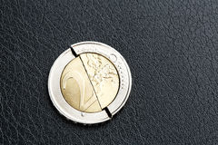 Euro crisis - broken coin Stock Photos
