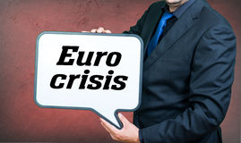 Euro crisis. A businessmann with a whiteborad text is euro crisis Stock Image