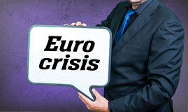 Euro crisis. A businessmann with a whiteborad text is euro crisis Stock Photo