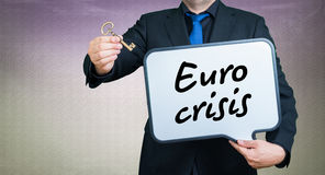 Euro crisis. A businessmann with a whiteborad text is euro crisis Stock Images