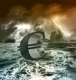 Euro crisis. Euro symbol floating in stormy sea Royalty Free Stock Photo