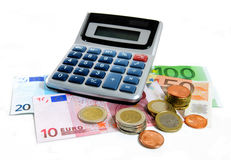 Euro Currency. Euro banknotes with coins and calculator Stock Photo