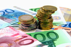 Euro Currency. Euro coins and cents on banknotes Royalty Free Stock Photo