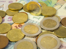 Euro currency above leu. Bunch of euros on top of bunch of leu papers Stock Photography
