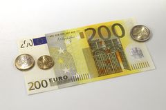 200 Euro currency banknote and Euro coins, European Union royalty free stock images