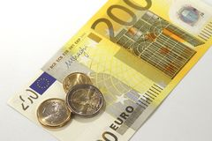 200 Euro currency banknote and Euro coins, European Union royalty free stock photos