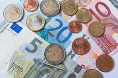 Euro currency banknotes and coins Stock Photo