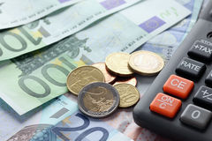 Euro currency and calculator Royalty Free Stock Photo
