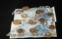 Euro currency in chains Royalty Free Stock Photo