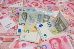 EURO currency on China yuan banknotes Stock Photography