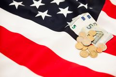 5 Euro currency and coins lie on the background of the flag of t Royalty Free Stock Photo