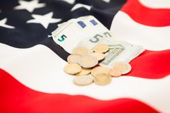 Euro currency and coins lie on the background of the flag of the Royalty Free Stock Photos
