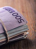 Euro currency. Euro money. Close-up Of A Rolled Euro Banknotes On Wooden table Royalty Free Stock Images