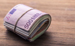 Euro currency. Euro money. Close-up Of A Rolled Euro Banknotes On Wooden table Royalty Free Stock Image