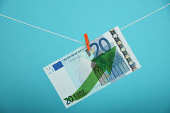 Euro currency growth illustrated over blue. European economy growth, strengthening of Euro currency, twenty Euro banknote with green arrow up hanged ascending Royalty Free Stock Photos