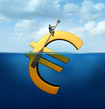 Euro Currency Guidance. Financial concept as a european money icon floating in the water with a businessman using an oar to steer and guide the economic symbol Royalty Free Stock Photos
