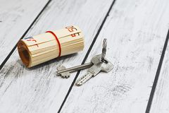 Euro currency money and a door key Stock Images