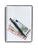 Euro currency and pen on blank notebook Stock Image