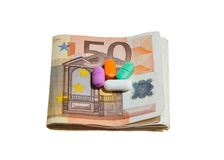 Euro Currency and Pills Royalty Free Stock Images