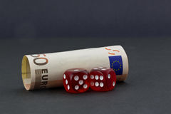 Euro currency placed with red dice reflects gamble and risk Stock Photo