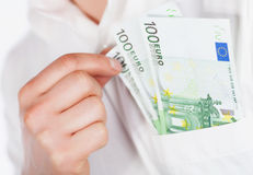 Euro currency in pocket Stock Photos