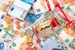Euro currency and shopping cart Royalty Free Stock Image