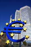 Euro currency sign. Modern sculpture of European currency sign with high rise office buildings in background, Frankfurt, Germany stock image