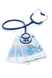EURO currency with stethoscope over it - isolated on white Royalty Free Stock Photography