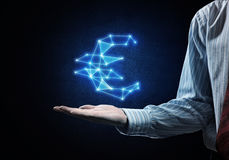 Euro currency symbol. Close of businessman hand showing in palm glowing euro sign Stock Image