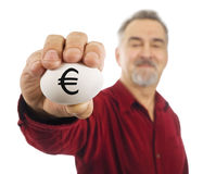 Euro currency symbol on white nest egg Royalty Free Stock Photos