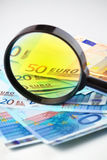 Euro currency under a magnifying glass Royalty Free Stock Photo