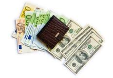 Euro, dólares e livro de nota foto de stock