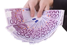 Euro d'argent dans la main de fille. Image stock