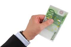 Euro da terra arrendada da mão do homem de negócios Fotografia de Stock Royalty Free