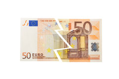 Euro in Danger. A 50-euro bill cut in two, representing the financial crisis in Greece, and generally in Europe Stock Photography