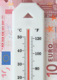 Euro debt. Overheated thermometer on top of a euro banknote Royalty Free Stock Photo
