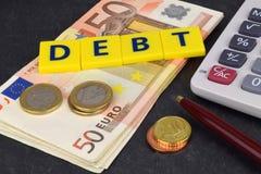 Euro Debt. A Euro debt still life, with a calculator, coins, notes and pen Stock Photography