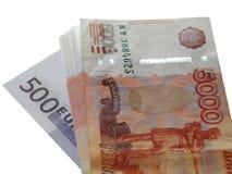 Euro dei soldi con un pacco di 5000 rubli Immagine Stock Libera da Diritti