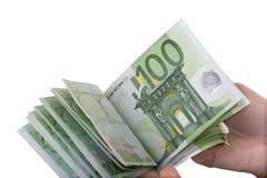 Euro del dinero en mano de la muchacha. Foto de archivo libre de regalías