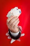 Euro della holding della mano Fotografia Stock Libera da Diritti