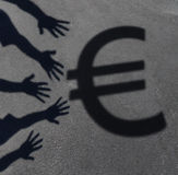 Euro Demand. As the cast shadow of a group of hands reaching out to grab the European currency symbol as a financial and business concept or money financing Royalty Free Stock Photo