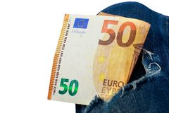 Euro in a denim hole. Fifty euro in a hole of jeans stock photography