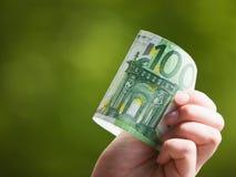 Euro in der Hand Stockfotografie