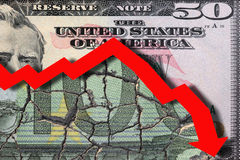 Euro devaluation. Devaluation of Euro against US Dollar with Chart pointing downwards Royalty Free Stock Photo