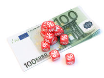 100 euro dice. Group a percentage dice over a pile of 100 euro's Stock Photo