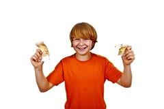 Euro die rond een jongenshoofd vliegen Royalty-vrije Stock Fotografie